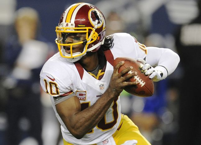 Washington Redskins quarterback Robert Griffin III (10) scrambles out of the pocket in the second half of an NFL football game against the Dallas Cowboys Thursday, Nov. 22, 2012 in Arlington, Texas. (AP Photo/Matt Strasen)