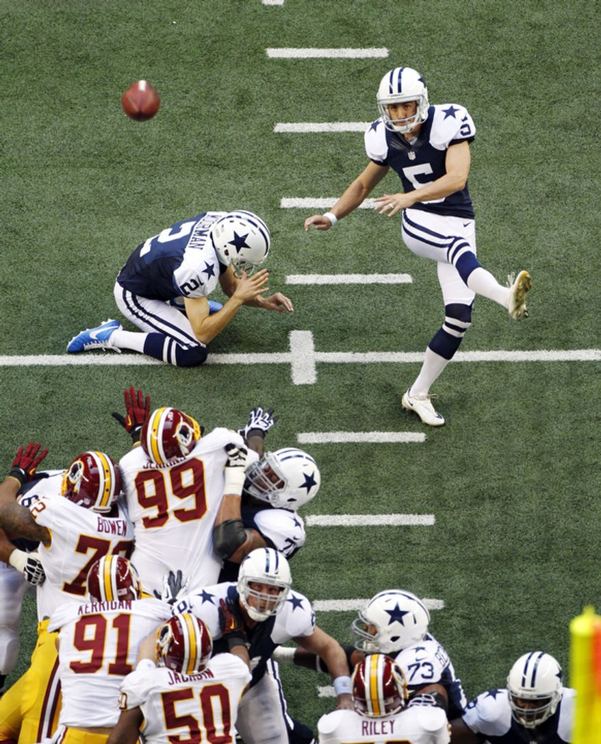 Dallas Cowboys kicker Dan Bailey (5) makes a field goal against the Washington Redskins in the first half of an NFL football game, Thursday, Nov. 22, 2012, in Arlington, Texas. (AP Photo/Tim Sharp)