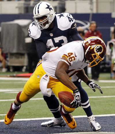 Washington Redskins' Alfred Morris (46) runs into the end zone for a touchdown in front of Dallas Cowboys' Gerald Sensabaugh (43) in the first half of an NFL football game, Thursday, Nov. 22, 2012, in Arlington, Texas. (AP Photo/Tim Sharp)