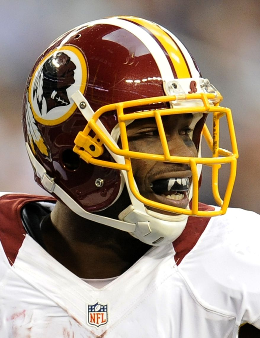 Washington Redskins wide receiver Pierre Garcon, wears a mouth guard with vampire teeth designed into it during the first half of an NFL football game against the Dallas Cowboys Thursday, Nov. 22, 2012 in Arlington, Texas. (AP Photo/Matt Strasen)
