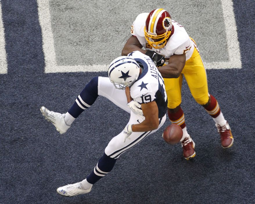 Dallas Cowboys wide receiver Miles Austin (19) is unable to come down with a pass in the end zone as Washington Redskins' London Fletcher (59) applies a hit in the first half of an NFL football game Thursday, Nov. 22, 2012, in Arlington, Texas. (AP Photo/Tim Sharp)