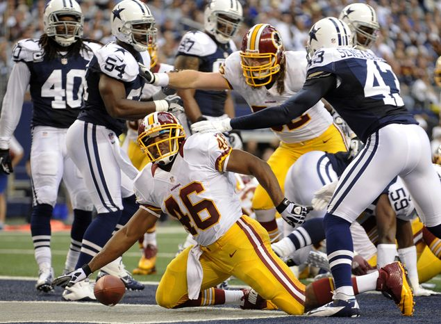 Washington Redskins running back Alfred Morris (46) celebrates after running for a touchdown in front of Dallas Cowboys' Gerald Sensabaugh (43) in the first half of an NFL football game, Thursday, Nov. 22, 2012, in Arlington, Texas. (AP Photo/Matt Strasen)