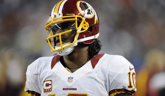 ** FILE ** Washington Redskins quarterback Robert Griffin III (AP Photo/Matt Strasen)