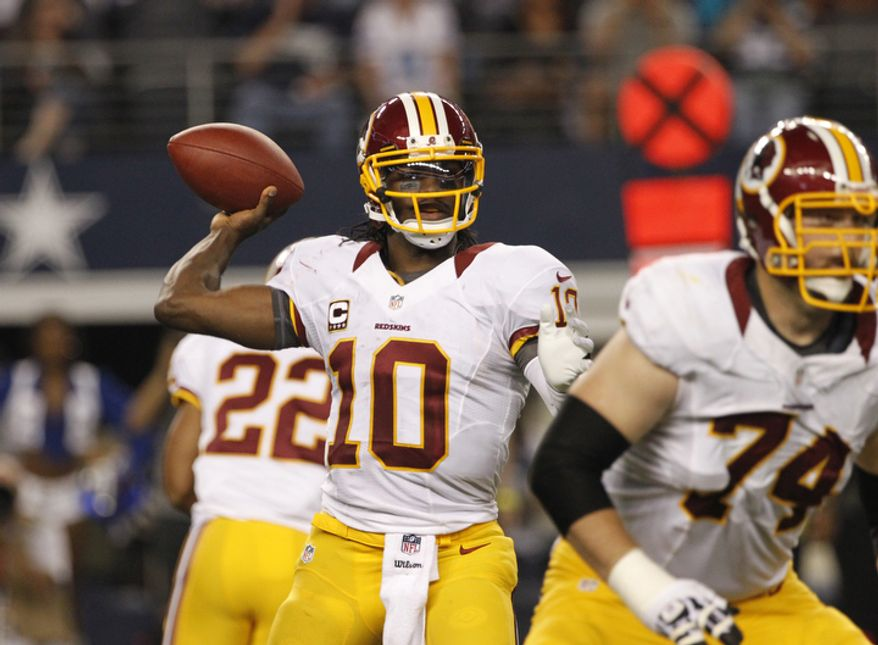 Washington Redskins quarterback Robert Griffin III (10) passes against the Dallas Cowboys in the second half of an NFL football game Thursday, Nov. 22, 2012, in Arlington, Texas. (AP Photo/Tim Sharp)