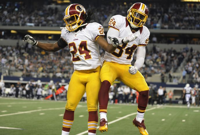 Washington Redskins tight end Niles Paul (84) and DeJon Gomes (24) celebrate a touchdown catch by Paul against the Dallas Cowboys in the second half of an NFL football game Thursday, Nov. 22, 2012 in Arlington, Texas. (AP Photo/Matt Strasen)