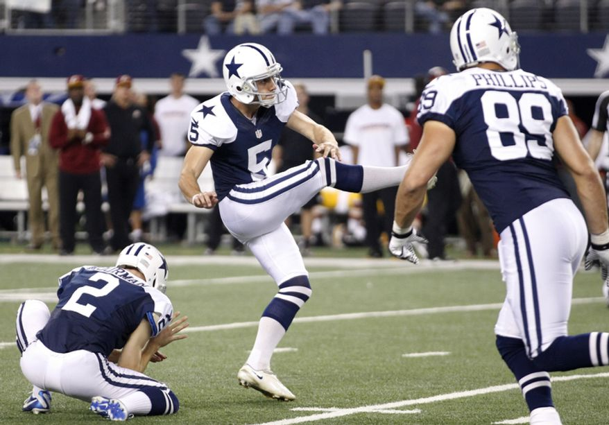 Dallas Cowboys' Brian Moorman (2), John Phillips (89) and Dan Bailey (5) look on at Baileys successful field goal against the Washington Redskins late in the second half of an NFL football game against the Washington Redskins  Thursday, Nov. 22, 2012 in Arlington, Texas. The Redskins won 38-31. (AP Photo/Tim Sharp)