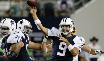 Dallas Cowboys quarterback Tony Romo (9) passes as Nate Livings (71) helps against pressure in the second half of an NFL football game against the Washington Redskins, Thursday, Nov. 22, 2012, in Arlington, Texas. (AP Photo/Tim Sharp)