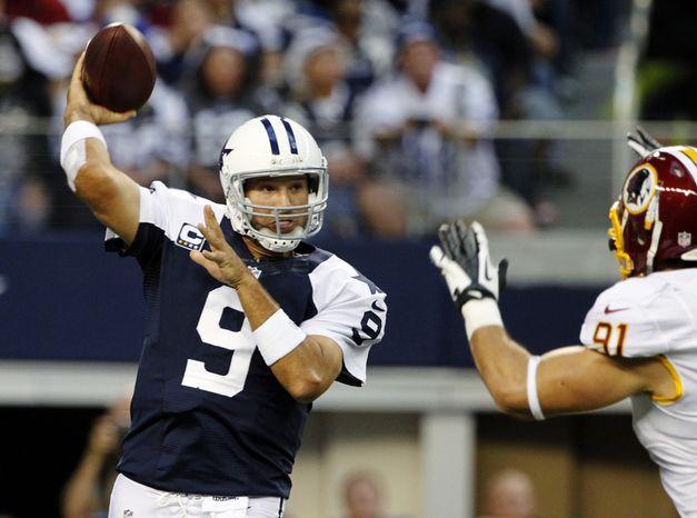 Dallas Cowboys quarterback Tony Romo (9) passes under pressure from Washington Redskins outside linebacker Ryan Kerrigan (91) in the first half of an NFL football game, Thursday, Nov. 22, 2012 in Arlington, Texas. (AP Photo/Tim Sharp)