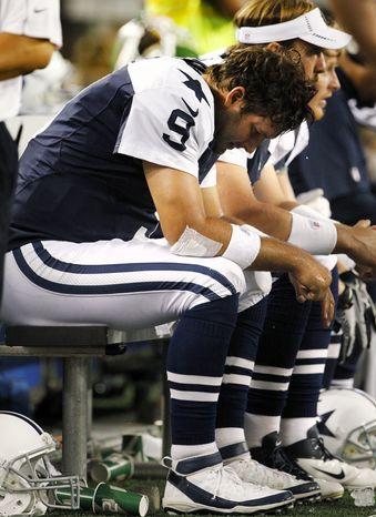 Dallas Cowboys quarterback Tony Romo (9) sits on the bench in the second half of an NFL football game against the Washington Redskins, Thursday, Nov. 22, 2012, in Arlington, Texas. (AP Photo/Tim Sharp)