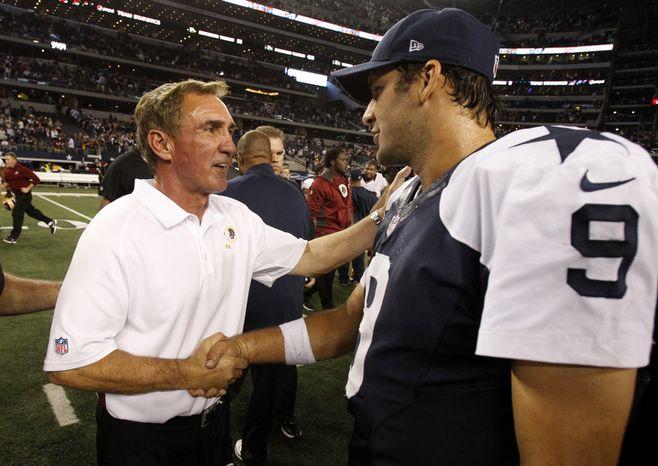 Washington Redskins head coach Mike Shanahan, left, shakes hands with Dallas Cowboys quarterback Tony Romo (9) following their NFL football game, Thursday, Nov. 22, 2012, in Arlington, Texas. The Redskins won 38-31. (AP Photo/Tim Sharp)
