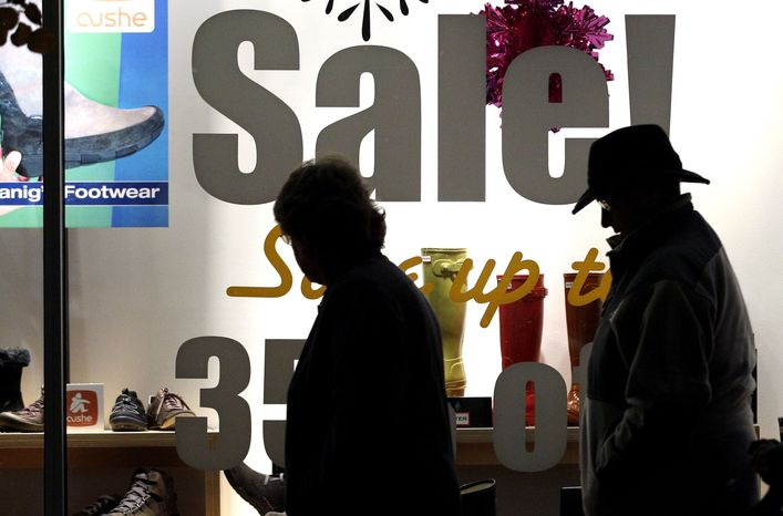 ** FILE ** Shoes on sale are displayed at a store as the busy holiday shopping season begins in Chicago, on Wednesday, Nov. 21, 2012. (AP Photo/Nam Y. Huh)