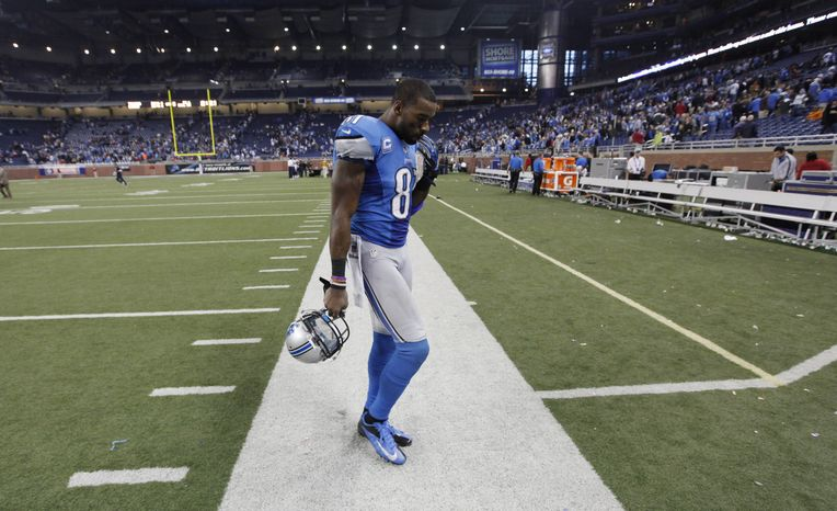 Detroit Lions wide receiver Calvin Johnson (81) walks off the field after the Lions' 34-31 loss to the Houston Texans in overtime of an NFL football game at Ford Field in Detroit, Thursday, Nov. 22, 2012. (AP Photo/Paul Sancya)