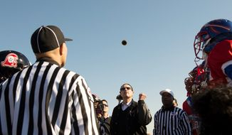 **FILE** Washington, D.C. Mayor Vincent C. Gray tosses the coin before the game as Anacostia High School faces Dunbar High School for the 43nd Annual DCIAA Turkey Bowl Varsity Football Championship at Eastern High School in Washington, D.C., Thursday, Nov. 22, 2012. (Rod Lamkey Jr./The Washington Times)