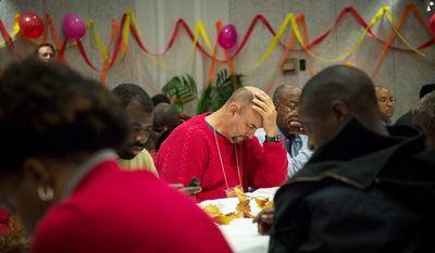 Central Union Mission resident James Higdon, 56, pauses during the opening prayer during the Thanksgiving Day dinner at the Central Union Mission in Washington, D.C., Thursday, Nov. 22, 2012. (Rod Lamkey Jr./The Washington Times)