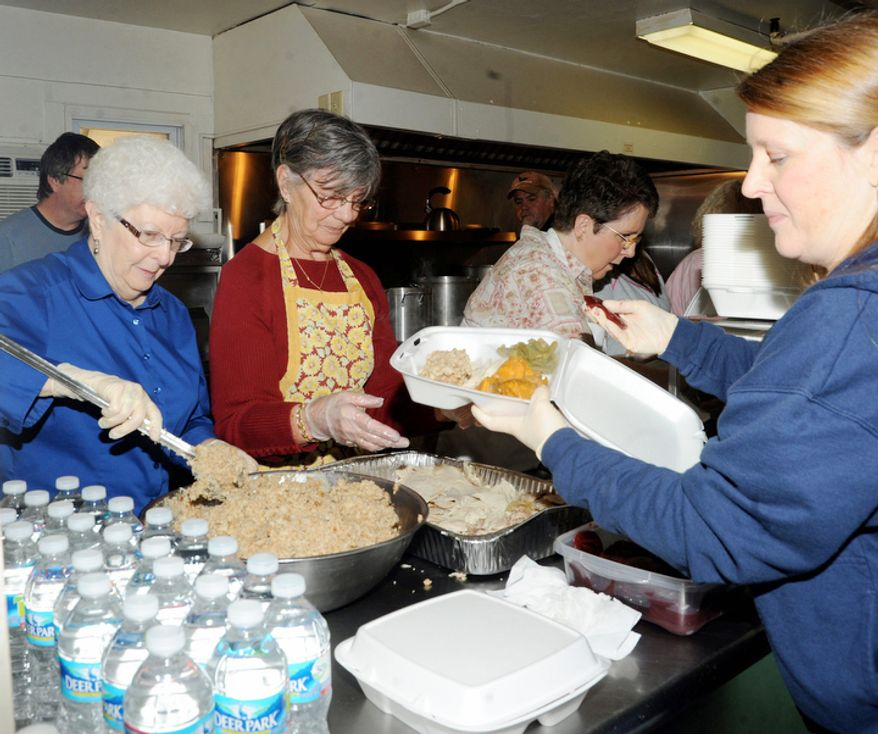From left, Jeannie Hennen, Zella Sigley, Carrol Hatfield and Pam OíDell fill plates at the Union Mission in Fairmont, W.Va. Thursday Nov. 22, 2012, with a traditional Thanksgiving dinner of turkey and all the trimmings to be deliver to those who would not otherwise have a Thanksgiving dinner. This year the mission volunteers deliveried over 800 meals (AP Photo/Times West Virginian, Tammy Shriver)