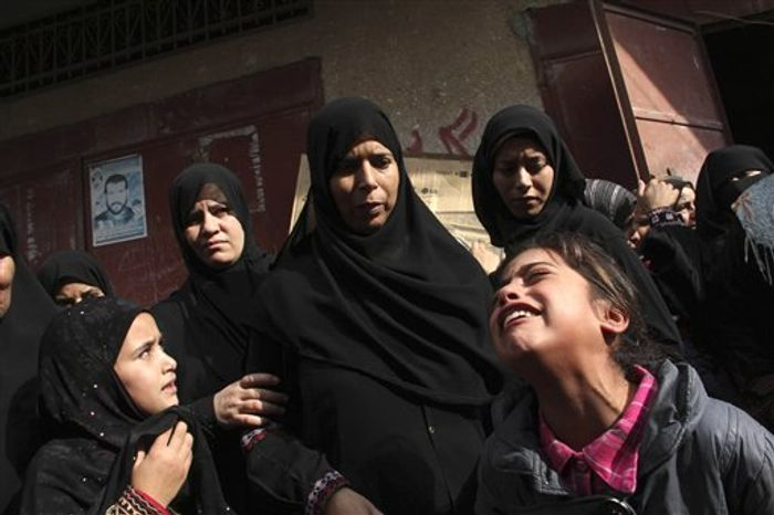 Palestinian relatives cry during a funeral of Ibrahim Abu Nasr, 61, and his daughter Amira, 19, in Khan Younis, Gaza Strip, Thursday, Nov. 22, 2012. The father and his daughter were killed in an Israeli air strike yesterday, Palestinian health officials said. (AP Photo/Hatem Omar)