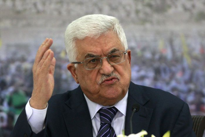 **FILE** Palestinian President Mahmoud Abbas speaks Nov. 16, 2012, during a meeting of the Palestinian leadership at his compound in the West Bank city of Ramallah. (Associated Press)
