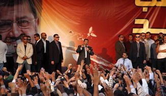 Egyptian President Mohammed Morsi speaks to supporters outside the Presidential palace in Cairo on Nov. 23, 2012. Opponents and supporters of Mohammed Morsi clashed across Egypt, the day after the president granted himself sweeping new powers that critics fear can allow him to be a virtual dictator. (Associated Press)