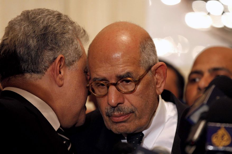 **FILE** Hamdeen Sabahi (left), former Egyptian presidential candidate, speaks Nov. 22, 2012, to Mohamed El Baradei, former director of the U.N.'s nuclear agency and Nobel peace laureate, during a news conference in Cairo to decry what was interpreted as a de facto declaration of emergency law by Egyptian President Mohammed Morsi. (Associated Press)
