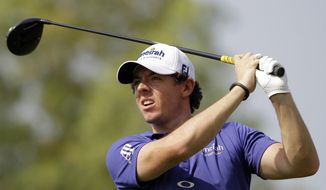 Rory McIlroy plays a ball on the 2nd hole during the first round of the DP World Golf Championship in Dubai, United Arab Emirates, on Nov. 22, 2012. (Associated Press)