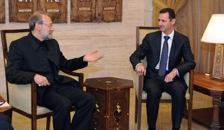In this photo released by the Syrian official news agency SANA, Syria President Bashar Assad, right, meets with the speaker of the Iranian parliament, Ali Larijani (left) in Damascus, Syria, on Nov. 23, 2012. Larijani was in Damascus where he held talks with Assad and other officials before flying on to neighboring Lebanon. (Associated Press/SANA)