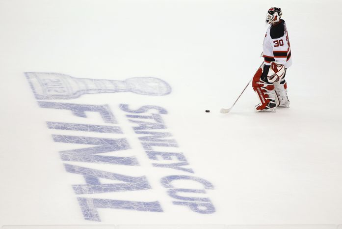 **FILE** New Jersey Devils goalie Martin Brodeur skates towards center ice during a timeout in the second period against the Los Angeles Kings during Game 6 of NHL hockey's Stanley Cup finals in Los Angeles on June 11, 2012. (Associated Press)