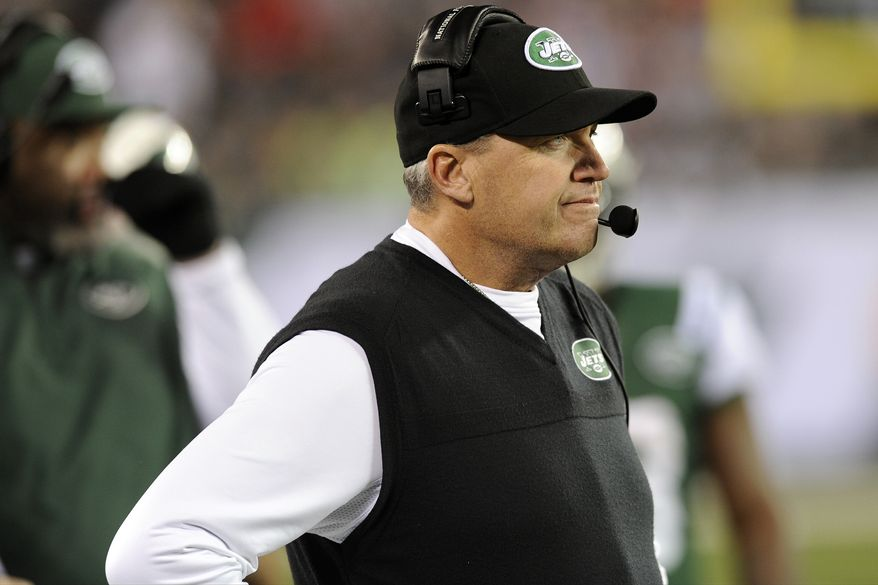 **FILE** New York Jets head coach Rex Ryan reacts after Jets quarterback Mark Sanchez fumbled and New England Patriots' Steve Gregory returned it for a touchdown during the first half of New England's 49-19 win on Nov. 22, 2012, in East Rutherford, N.J. (Associated Press)