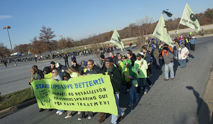 A long line of Walmart workers and community activists march in protest outside the Walmart in Capital Plaza Mall in Hyattsville, Md., on Nov. 23, 2012. (Barbara L. Salisbury/The Washington Times) ** FILE **