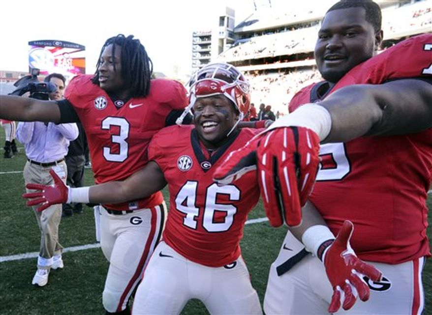 Georgia running back Todd Gurley (3), fullback Alexander Ogletree (46), and guard Mark Beard (79) celebrate their 42-10 win over Georgia Tech after an NCAA college football game, Saturday, Nov. 24, 2012, in Athens, Ga. (AP Photo/John Amis)