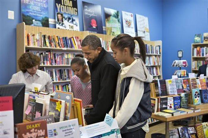 President Barack Obama, with daughters Sasha, left, and Malia, right, goes shopping at a small bookstore, One More Page, in Arlington, Va., Saturday, Nov. 24, 2012. (AP Photo/J. Scott Applewhite)