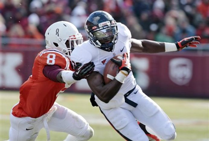 Virginia wide receiver Tim Smith (20) hauls in a touchdown pass as Virginia Tech safety Detrick Bonner (8) tries to make the stop during the first half of an NCAA college football game at Lane Stadium, Saturday, Nov. 24, 2012, in Blacksburg, Va. (AP Photo/Steve Helber)
