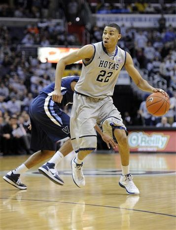 FILE - In this Feb. 25, 2012 file photo Georgetown University basketball forward Otto Porter (22) dribbles the ball against Villanova during a NCAA college basketball game in Washington. Porter, Georgetown's best player is a sophomore. Two other members of the starting lineup also could be guys who were freshmen a year ago, Greg Whittington and Mikael Hopkins. There is not a single senior on coach John Thompson III's roster. And only two juniors are expected to see significant minutes. (AP Photo/Nick Wass, File)