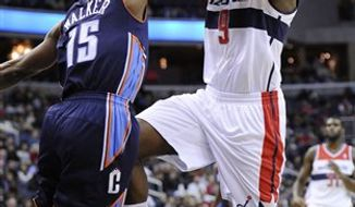 Washington Wizards forward Martell Webster (9) is fouled by Charlotte Bobcats guard Kemba Walker (15) during the second half of an NBA basketball game on Saturday, Nov. 24, 2012, in Washington. Charlotte won 108-106 in double overtime. (AP Photo/Nick Wass)