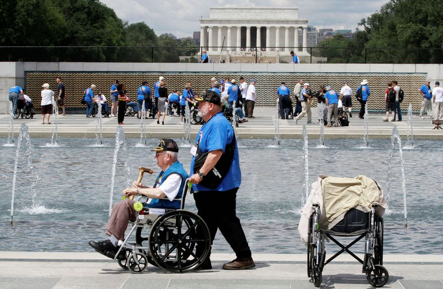 Marvin Kincaid, 85, of Thayer, Mo., a private in the Army infantry during World War II, made it to the World War II Memorial in June as honor flight veterans visited on the 68th anniversary of D-Day. As many as 100 veterans of the war missed their chance to travel to D.C. after money disappeared from a Kansas nonprofit that organized free trips for them. (Associated Press)