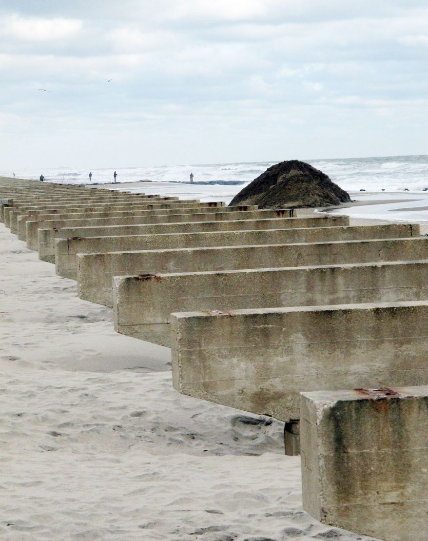 Concrete slabs that once supported a boardwalk lie exposed after the wrath of Superstorm Sandy, which washed away millions of tons of sand and devastated beaches along the New Jersey coastline. (Associated Press)