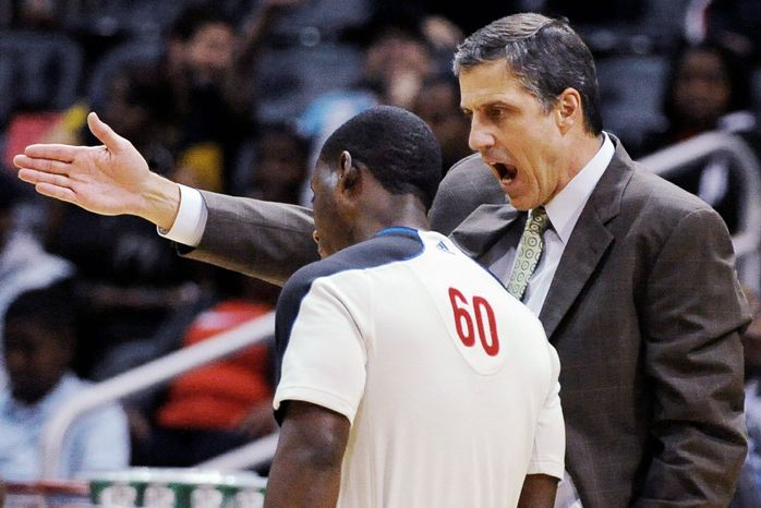 Washington Wizards head coach Randy Wittman argues with referee James Williams in the second half of an NBA basketball game against the Atlanta Hawks at Philips Arena in Atlanta, Wednesday, Nov. 21, 2012. Atlanta won 101-100 in overtime. (AP Photo/David Tulis)