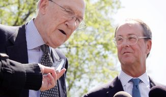 ** FILE ** In this Nov. 25, 2012, file photo, former Sen. Alan K. Simpson (left) and Erskine Bowles were co-chairmen of President Obama's deficit-reduction commission and have formed a new group called Fix the Debt to press for a solution to the nation's severe deficit problem. (Associated Press)