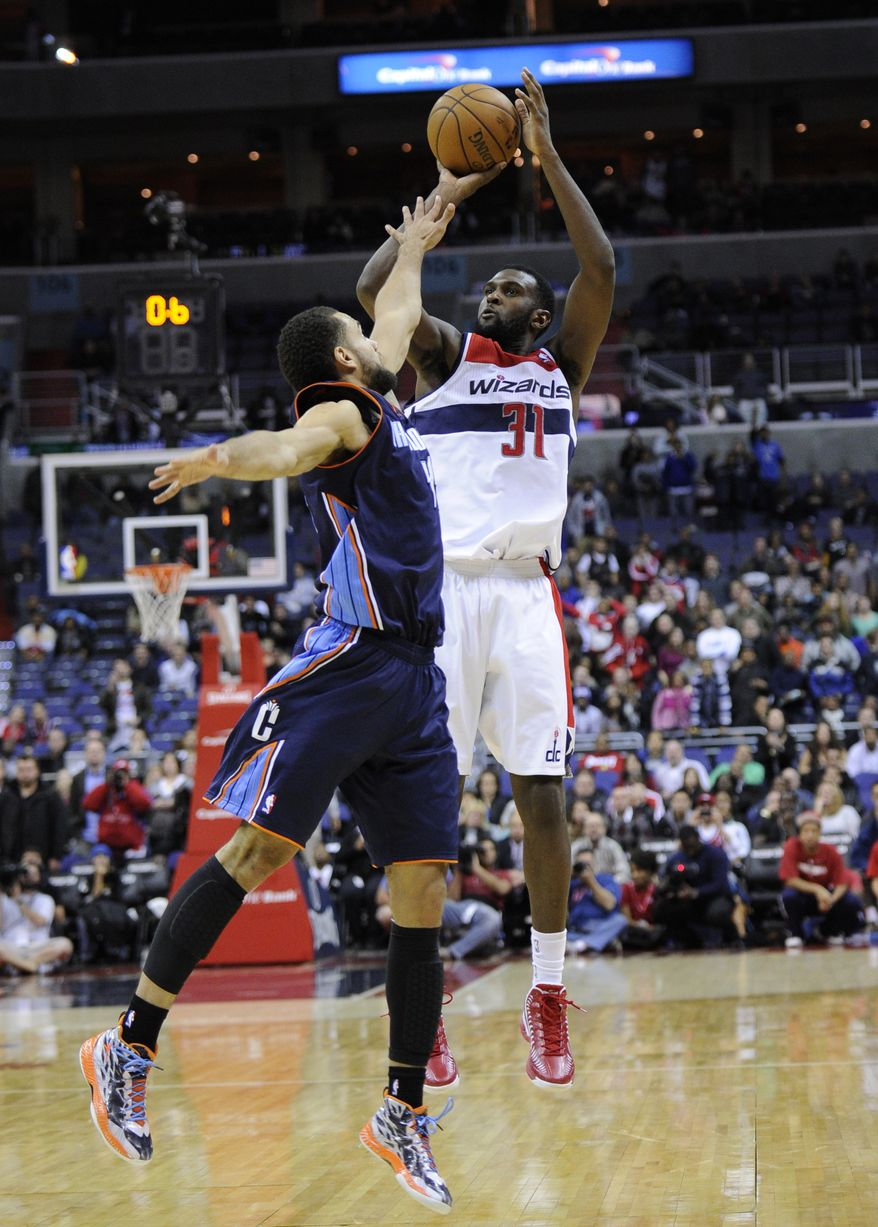 Washington Wizards forward Chris Singleton (31) shoots against Charlotte Bobcats forward Jeffery Taylor, left, during the first overtime period of an NBA basketball game on Saturday, Nov. 24, 2012, in Washington. Charlotte won 108-106. (AP Photo/Nick Wass)