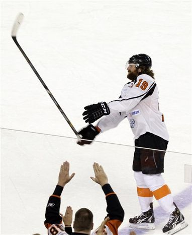 New Jersey Team's Scott Hartnell tosses his stick to fans after a charity hockey game against the New York Team in Atlantic City, N.J., Saturday, Nov. 24, 2012. New York won 10-6. (AP Photo/Mel Evans)