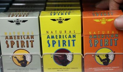 FILE - In this Tuesday, Feb. 1, 2011 file photo, Reynolds American cigarette brand American Spirit are on display at a liquor store in Palo Alto, Calif. (AP Photo/Paul Sakuma, File)