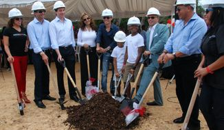 Singer Marc Anthony (fifth from left) poses for photos with members of his Maestro Cares Foundation and local authorities during the groundbreaking ceremony for new facilities for the Children of Christ orphanage in La Romana, Dominican Republic, on Friday, Nov. 23, 2012. (AP Photo/Maestro Cares Foundation)