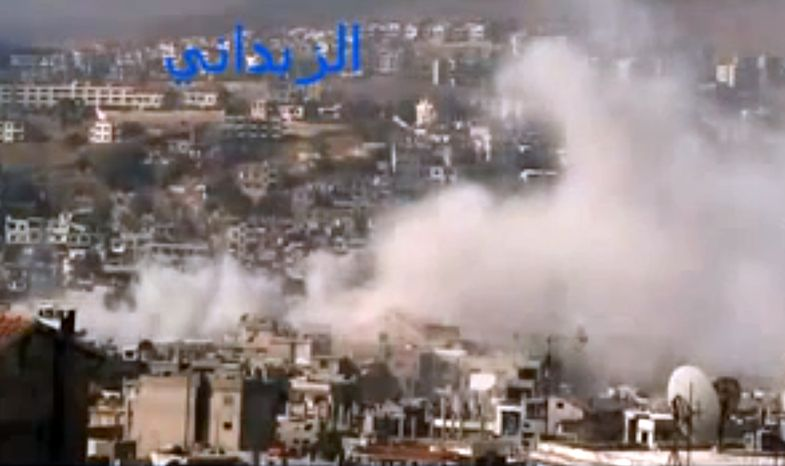 In this image taken from video that has been authenticated based on its contents and other AP reporting, smoke rises from buildings after government shelling in the Damascus suburb of Zabadani, Syria, on Friday, Nov. 23, 2012. (AP Photo/Shaam News Network via AP video)