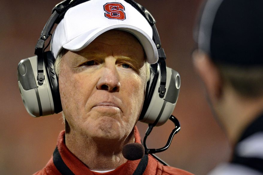 FILE - In this Nov. 17, 2012, file photo, North Carolina State head coach Tom O'Brien looks to an official regarding a call during the second half of an NCAA college football game against Clemson at Memorial Stadium in Clemson, S.C. The school fired O'Brien Sunday, Nov. 25, ending a tenure that was good enough to reach four bowls yet never could reach the ACC championship game. (AP Photo/Richard Shiro, File)