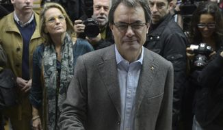 Artur Mas, leader of the center-right Catalan Nationalist Coalition (CiU) party, casts his vote in Barcelona during Catalan regional elections on Sunday, Nov. 25, 2012. (AP Photo/Manu Fernandez)