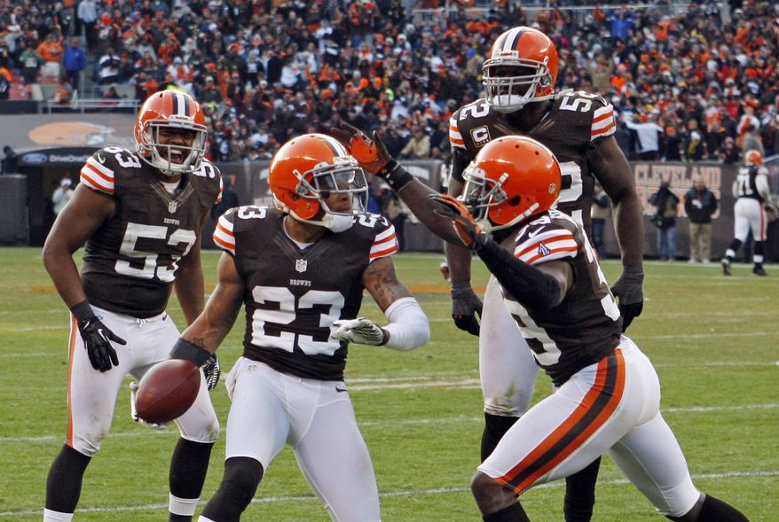 Cleveland Browns cornerback Joe Haden (23) celebrates a fourth quarter interception against the Pittsburgh Steelers with Craig Robertson (53), D'Qwell Jackson (52) and Tashaun Gipson in an NFL football game Sunday, Nov. 25, 2012, in Cleveland. (AP Photo/Ron Schwane)