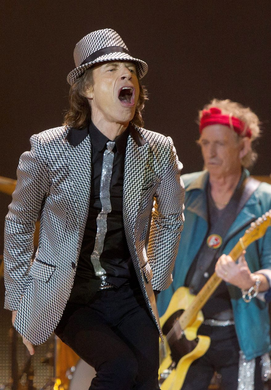 Mick Jagger and Keith Richards (right) perform in east London on Sunday during the first of five concerts the Rolling Stones are performing to mark its 50th anniversary. Three of the concerts will be in the New York area. (Invision via Associated Press)