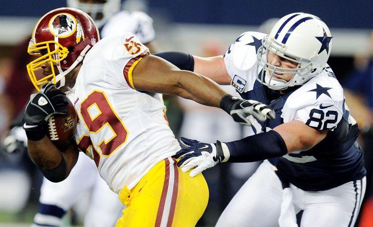 Redskins linebacker London Fletcher went on the offensive, shaking a tackle attempt by Dallas tight end Jason Witten after intercepting a pass Thursday. (Associated Press)