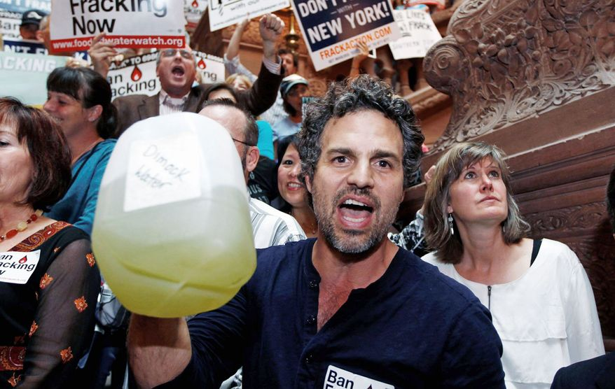 Actor Mark Ruffalo holds a bottle of well water from Dimock, Pa., during a rally in Albany, N.Y., last spring. The group is one of many calling on Gov. Andrew Cuomo to ban hydraulic fracturing, for gas in the Marcellus Shale region. (Associated Press)