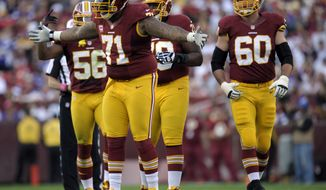 ** FILE ** Washington Redskins tackle Trent Williams didn't practice Monday because a deep thigh bruise sustained during the Thanksgiving game. He thinks he'll be able to play Dec. 3, however. (AP Photo/Cliff Owen)