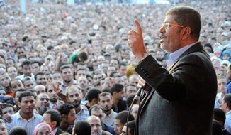 """Egyptian President Mohammed Morsi speaks to supporters outside the Presidential Palace in Cairo on Friday, Nov. 23, 2012. MENA, Egypt's official news agency, says the country's highest body of judges has called the president's recent decrees an """"unprecedented assault on the independence of the judiciary and its rulings."""" In a statement carried by MENA on Saturday, the Supreme Judicial Council said it regrets the declarations Mr. Morsi issued Thursday. (AP Photo/Egyptian Presidency)"""